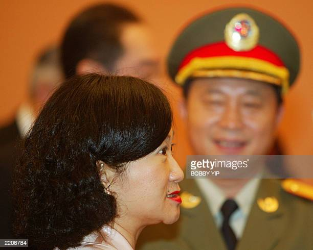 Hong Kong's Secretary for Security Regina Ip speaks beside a representative from China's People Liberation Army as they attend the signing of the...