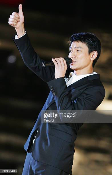 Hong Kong's star Andy Liu performs during the Award-giving Ceremony for the Fourth Olympic Songs Competition at the illuminated Worker People's...