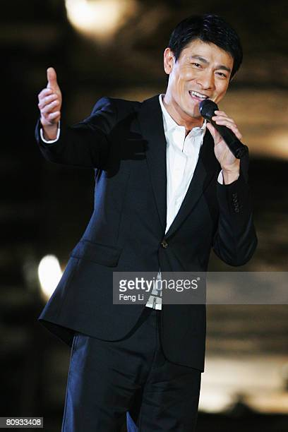Hong Kong's star Andy Liu performs during the Award-giving Ceremony for the 4th Olympic Songs Competition at the illuminated Worker People's Cultural...