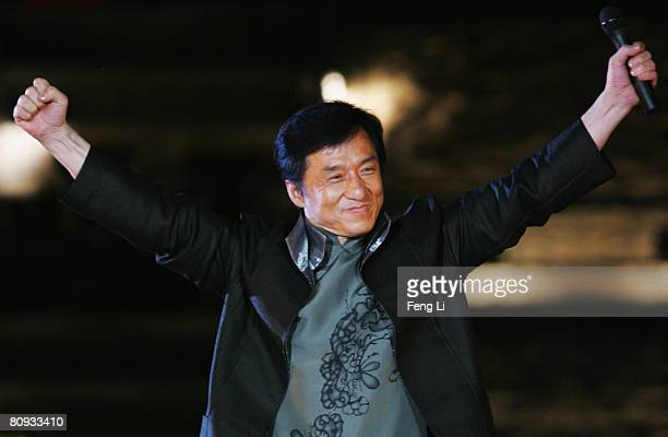 Hong Kong's star Jackie Chan performs during the Award-giving Ceremony for the fourtth Olympic Songs Competition at the illuminated Worker People's...