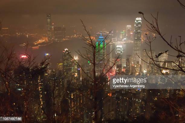 hong kong's victoria harbour at night as seen from victoria peak - argenberg stock pictures, royalty-free photos & images