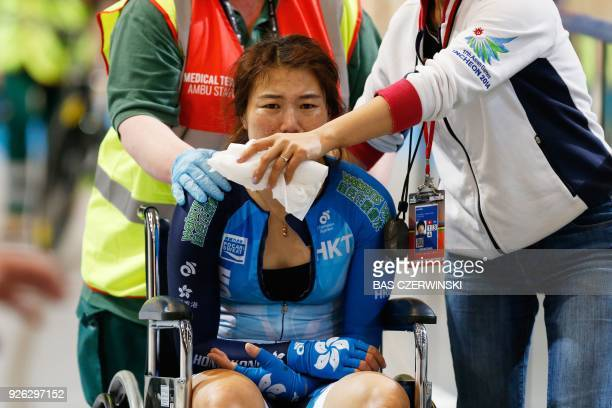 Hong Kong's Xiaojuan Diao cries after crashing with a jury member during the women's Omnium at the UCI Track Cycling World Championships in Apeldoorn...