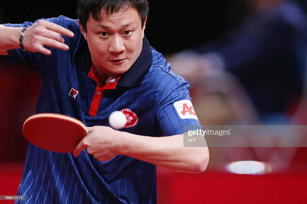 Hong Kong's Yuk Cheungplays against China's Hao Wang on May 16, 2013 in Paris, during the second round of the Men's Singles of the World Table Tennis Championships.