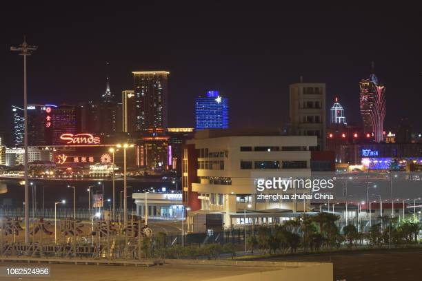 hong kong-zhuhai-macao bridge, zhuhai port at night - hong kong stock pictures, royalty-free photos & images