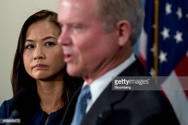 Hong Le Webb wife of Jim Webb former Senator from Virginia and former 2016 Democratic presidential candidate left looks on as her husband speaks...