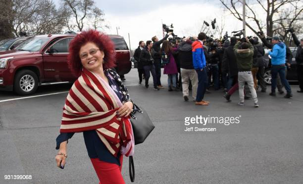 Hong Saccone wife of Republican Congressional Candidate Rick Saccone walks to their car while her husband is surrounded by media after voting in the...