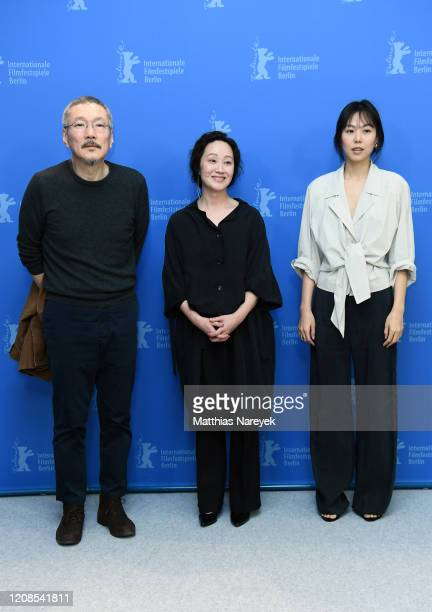 Hong Sangsoo Seo Younghwa and Kim Minhee attend the The Woman Who Ran photocall during the 70th Berlinale International Film Festival Berlin at Grand...