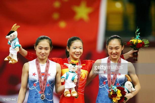 Hong Su Jong of the Democratic People's Republic of Korea , Cheng Fei of China and Hong Un Jong of the Democratic People's Republic of Korea pose...