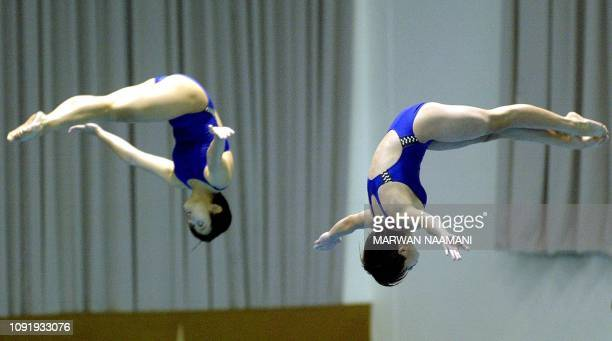 Hong thanh Tra and Mai Thi Yen of Vietnam perform during the women's 3m sychronized diving final at Sajik pool in Busan 08 October 2002 during the...