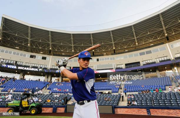 Hong WeiHan batter of National Baseball Team of Taiwan warms up before the friendly game of National Baseball Team of Nicaragua against the National...