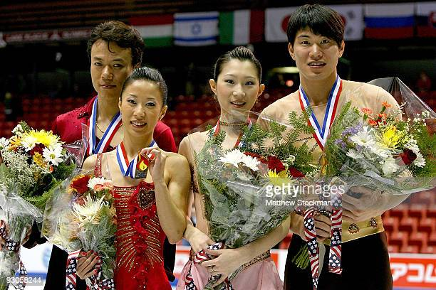 Hongbo Zhao Xue Shen Dan Zhang and Hao Zhang of China pose for photographers after the Pairs competition during the CancerNet Skate America at Herb...