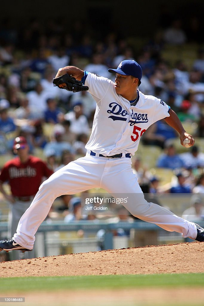 Hong-Chih Kuo #56 of the Los Angeles Dodgers pitches against the Arizona Diamondbacks in the eighth inning of the game at Dodger Stadium on July 31, 2011 in Los Angeles, California.