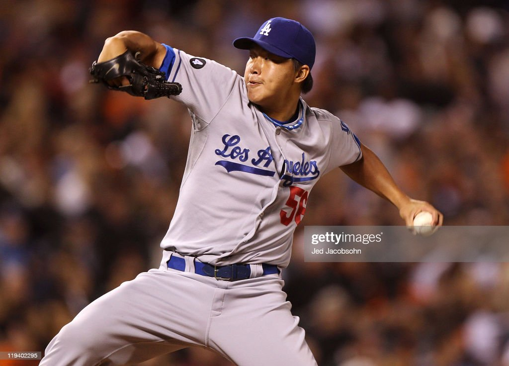 Hong-Chih Kuo #56 of the Los Angeles Dodgers pitches against the San Francisco Giants at AT&T Park on July 19, 2011 in San Francisco, California.