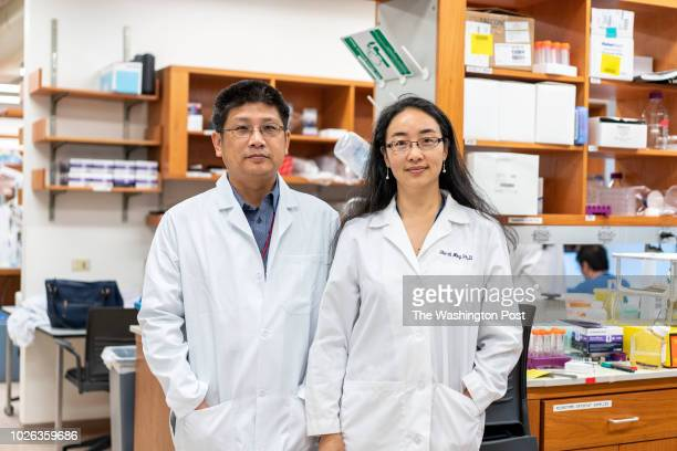 Hongjun Song PhD left and Guoli Ming MD PhD at the University of Pennsylvania Clinical Research Building in Philadelphia Pennsylvania on August 15...