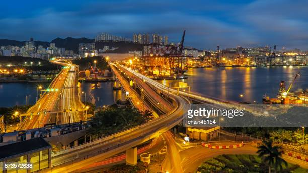 Hongkong in night with business port.