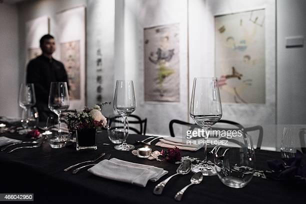 HongKongArtBaselfoodcultureFEATURE by Liz THOMAS This picture taken on March 10 2015 shows a table set up for guest to have a dinner at an art...