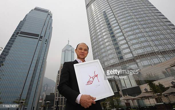 HongKong-fashion-people-Choo,INTERVIEW by Joyce WooThis photo taken on March 11, 2011 shows shoe designer Jimmy Choo posing with a picture of one of...