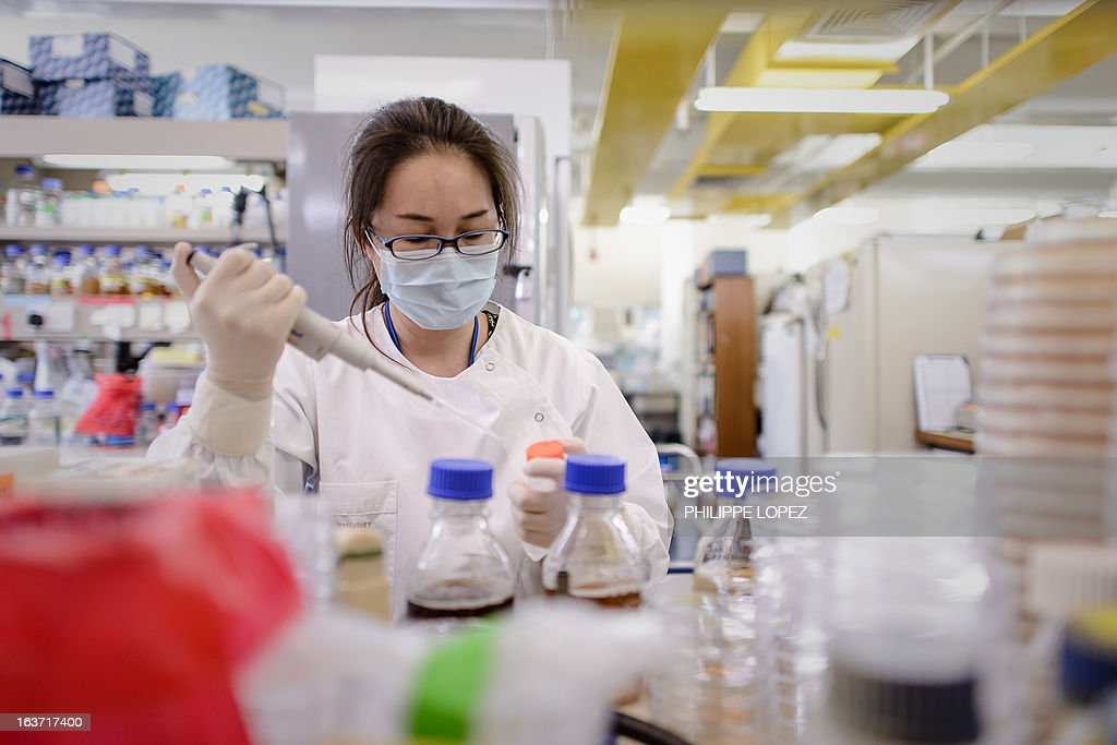 HongKong-health-disease-SARS-anniversary,FOCUS by Aaron Tam This picture taken on March 11, 2013 shows a woman working at a laboratory of Hong Kong University's Department of Microbiology at Queen Mary Hospital in Hong Kong. The Severe Acute Respiratory Syndrome (SARS) outbreak killed 299 people in 2003 in the southern Chinese city, another 500 people worlwide and sparked a major health scare, but experts said the paranoia that dogged the city a decade ago has left a legacy that changed Hong Kong people's lifestyle and personal hygiene. AFP PHOTO/Philippe Lopez