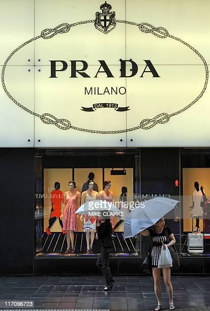 HongKongItalyluxuryfashionIPOPradaADVANCER by Peter Brieger People walk past a Prada shop on a rainy afternoon in Hong Kong on June 22 2011 Italian...