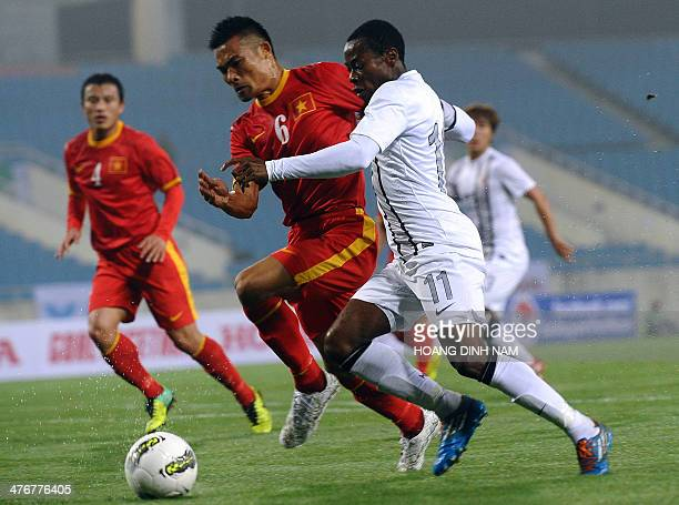Hongkong's forward Kwesi fights for the ball with Vietnam's defender Truong Dinh Luat during the Asian Cup 2015 qualifying football match between...