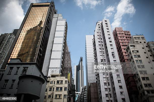 HongKongUSeconomypropertyFOCUS by Dennis CHONG This picture taken on October 22 2015 shows highrise buildings in Hong Kong Buoyed by recordlow...