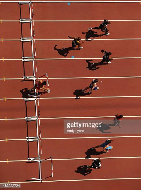 Honglin Zhang of China falls during the Men's 110 metres hurdles heats during day five of the 15th IAAF World Athletics Championships Beijing 2015 at...