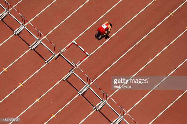 Honglin Zhang of China reacts after sustaining an injury in the Men's 110 metres hurdles heats during day five of the 15th IAAF World Athletics...