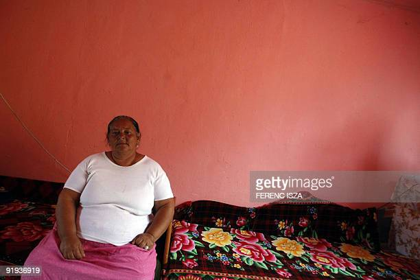 Hongrie les Roms d'Esztergom entre taudis et chômage Hungarian gypsy grandmother Joli sits on her bed at Toltes street in Esztergom 65 km from...