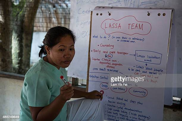 Honney a nurse from the Philippines gives briefing to her teammates on Lassa fever prevention at Gondama Referral Centre on March 7 2014 in Bo...