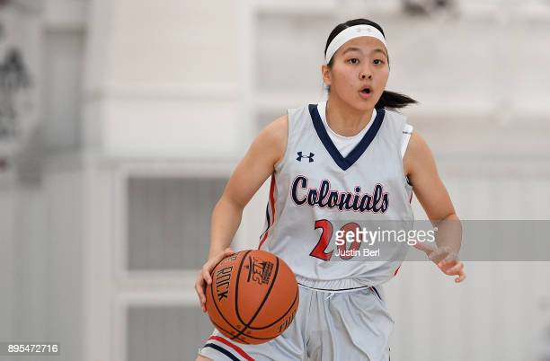 Honoka Ikematsu of the Robert Morris Colonials brings the ball up court in the first half during the game against the Kent State Golden Flashes at...