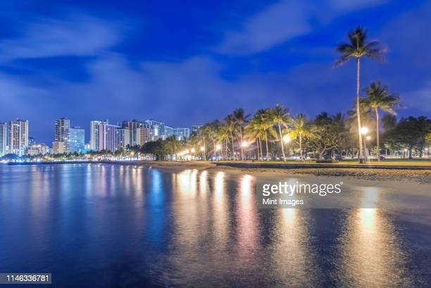 honolulu city skyline reflection in ocean, hawaii, united states - waikiki stock pictures, royalty-free photos & images