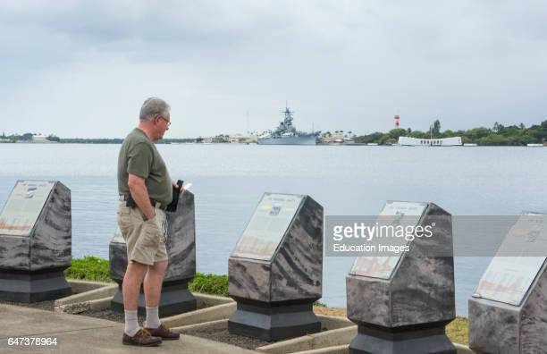 Honolulu Hawaii Pearl Harbor Memorial USS Arizona man looking at plaques war dead Japan bombing