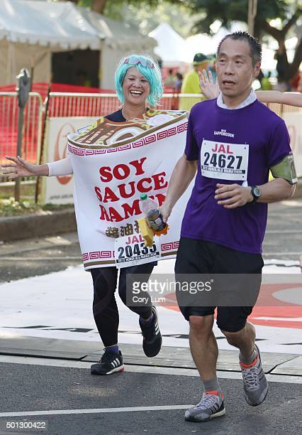 Honolulu Marathon runner dressed as a container of soy sauce finishes her race December 13 2015