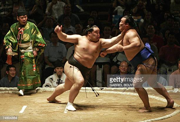 Grand champion or yokozuna Asashoryu of Mongolia beats Kasuganishiki from Japan on the first day of the Grand Sumo Tournament in Hawaii 2007 at the...