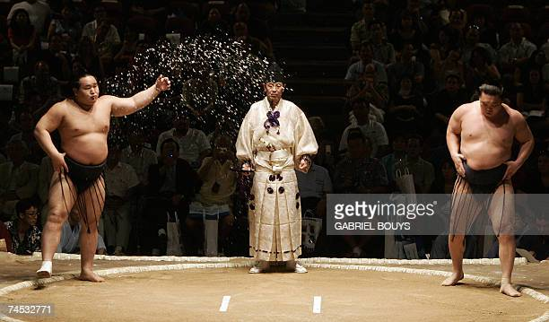 Grand champion or yokozuna Hakuho of Mongolia and fellow yokozuna Asashoryu also of Mongolia step into the ring to face off for the final of the...