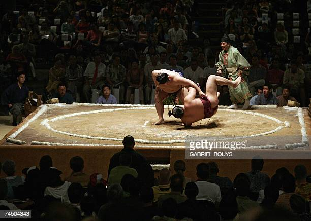 Sumo wrestlers take part in a bout during the first day of the Grand Sumo Tournament in Hawaii 2007 at the Neil S Blaisdell Arena in Honolulu Hawaii...