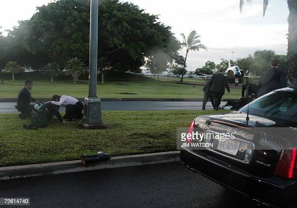 White House staff and US Secret Service rush to help after three or more Honolulu Police Department motorcycle police officers crashed while...