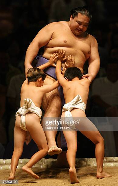 Young boys take on a sumo wrestler during an exhibition before the start of the first day of the Grand Sumo Tournament in Hawaii 2007 at the Neil S...
