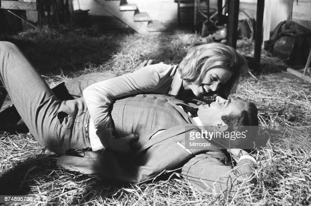 Honor Blackman as Pussy Galore and Sean Connery as James Bond seen here filming a fight scene which develops into a love scene in Goldfingers barn on...