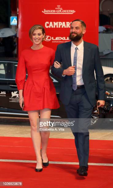 Honor Byrne and Sandro Kopp walk the red carpet ahead of the 'At Eternity's Gate' screening during the 75th Venice Film Festival at Sala Grande on...