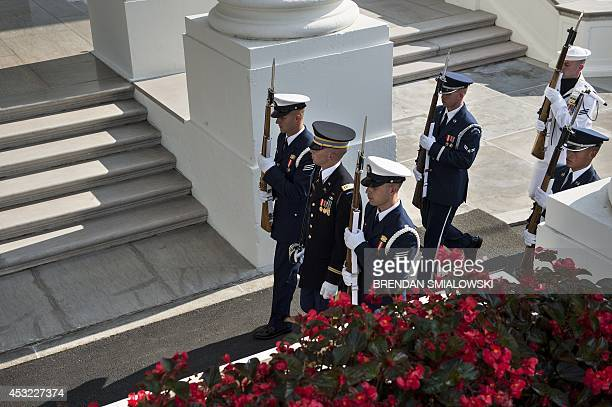 Honor guard arrive at the White House to greet guests for a group dinner during the US Africa Leaders Summit August 5 2014 in Washington DC AFP...