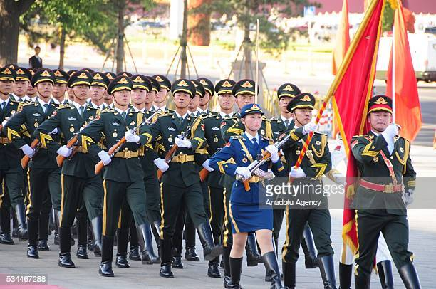 Honor guard march during an official welcome ceremony for Indian President prior to a meeting of Indian President Pranab Mukherjee and China's...