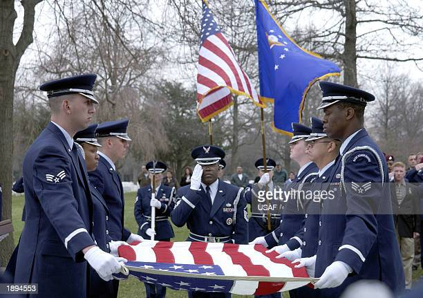 Honor Guard members of the 305th Air Mobility Wing of McGuire Air Force Base, New Jersey, remove a U.S. Flag from the casket of Master Sergeant...