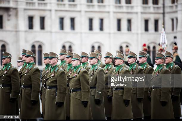 Honor guard soldiers stand in formation outside the Hungarian parliament building during a flagraising ceremony in Budapest Hungary on Thursday March...