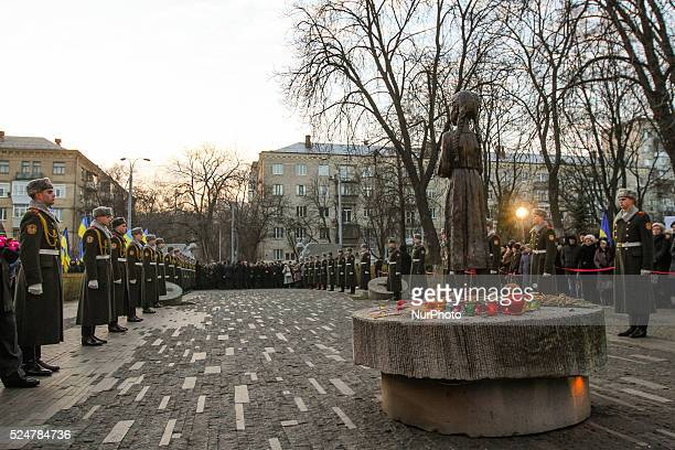 Honor guard soldiers stay next to the Famine victims memorial in Kyiv November 28 2015 On November 2829 Ukraine honors the memory of the victims of...