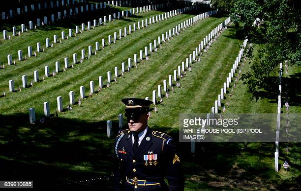 A honor guard stands still as the motorcade carrying US President Barack Obama arrives at the Tomb of the Unknown Soldier at Arlington National...