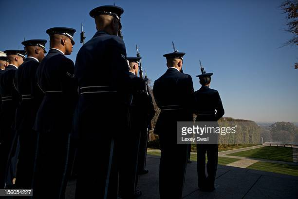 Honor Guards from each branch of the military walk in formation away from the Tomb of the Unknowns on Veteran's Day at Arlington National Cemetery on...