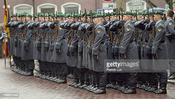Honor guards of the Bundeswehr pay their last respects to the coffin of former German Defence Minister Peter Struck after a memorial service on...