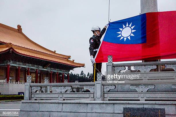 Honor guards prepare to raise the Taiwan flag in the Chiang Kaishek Memorial Hall square ahead of the Taiwanese presidential election on January 14...