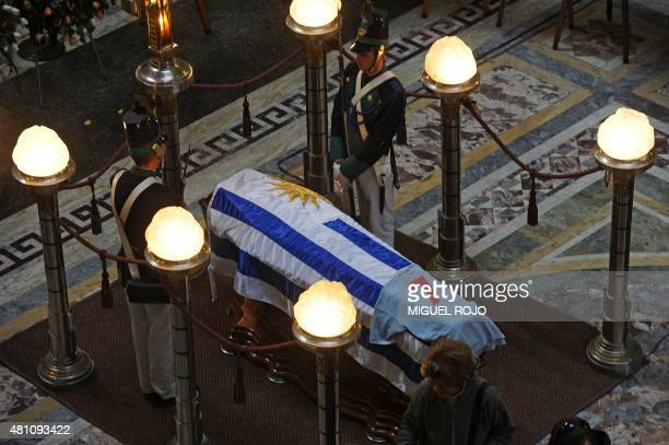 Honor guards stand next to Uruguayan former footballer Alcides Ghiggia's coffin covered with the Uruguayan flag and his jersey during his wake at the...